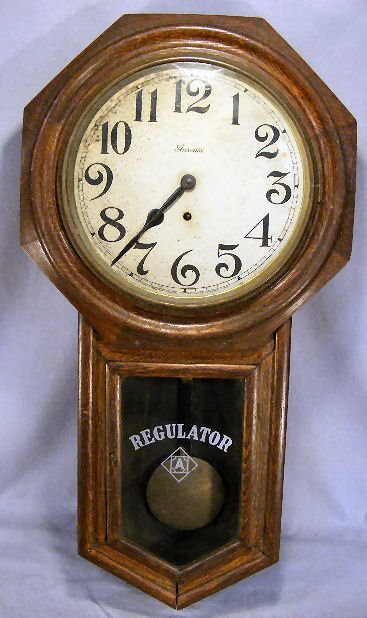 "9A: Ansonia oak case regulator clock, 32"" long, paper d"