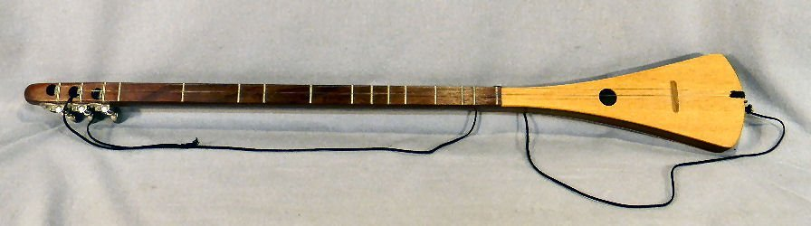 "19A: Strum stick guitar, labeled inside and signed ""Bob"
