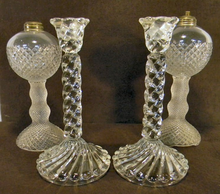 "6Y: Pair of glass candle holders 9.25"" high and two dia"