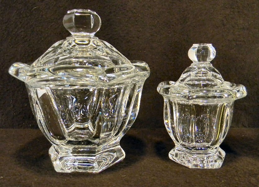 7Y: Two Baccarat covered jars, no spoons, smaller has m