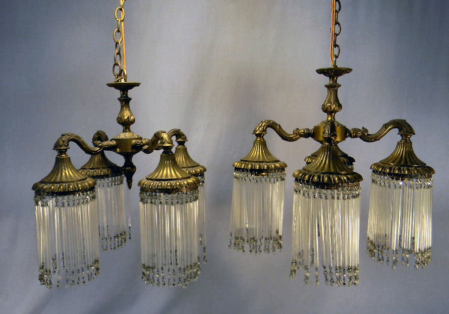 14Y: Pair of brass hanging light fixtures, with tubular