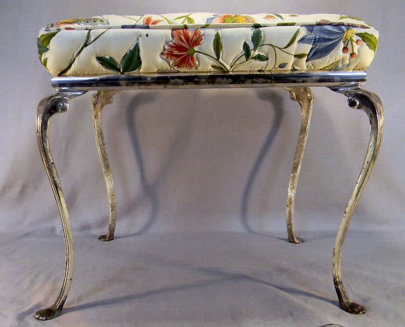20Y: Upholstered stool with silver colored metal frame,