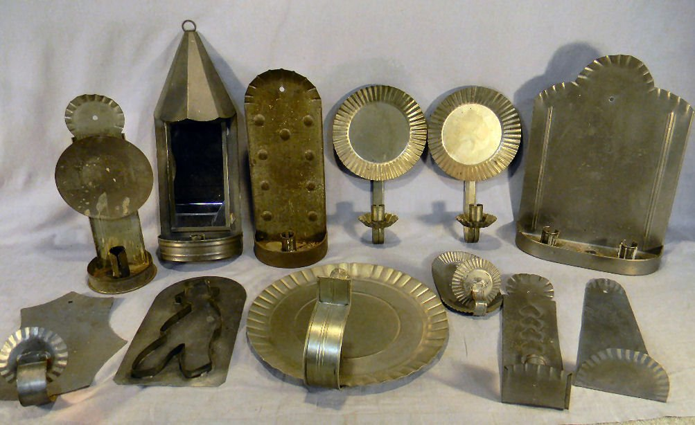 24Y: Lot of 11 tin wall sconces and one cookie cutter,