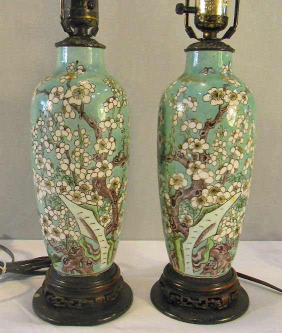 Pair of oriental pottery lamps with prunus blossoms dec
