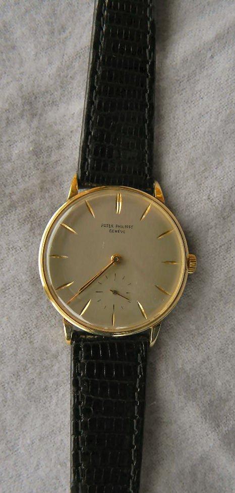 Estate Patek Philippe 18K yellow gold wristwatch, clean