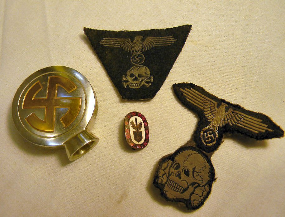Lot including WWII Nazi death head patches, enameled pi