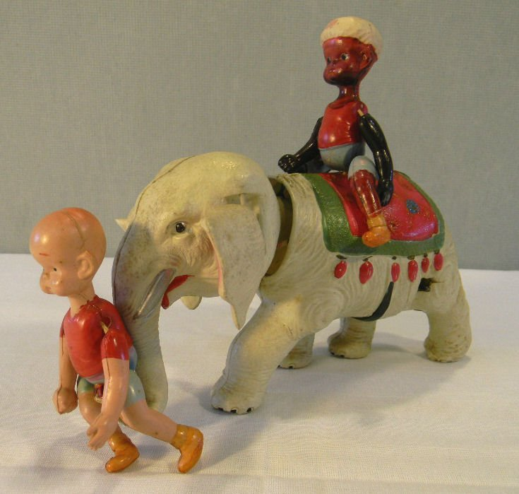 Celluloid Henry and the Mahout on elephant toy, made in
