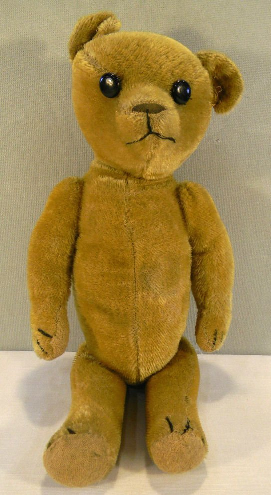 Old straw stuffed Teddy Bear, moving arms, legs and hea