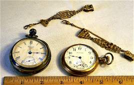 Two pocket watches and two gold filled watch chains, Am