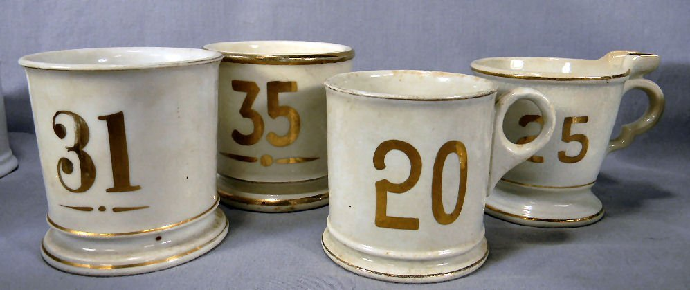 Lot of four (4) numbered shaving mugs, no chips, cracks