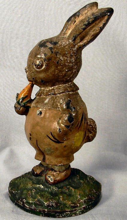 Cast iron rabbit with carrot door stop, 9 1/4in. High,