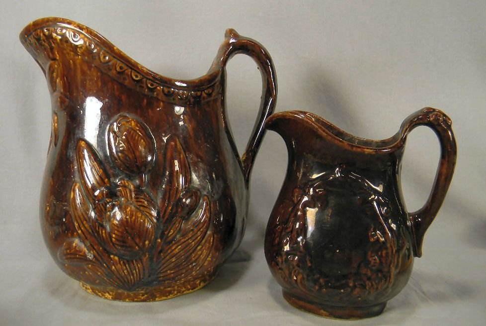 Two Rockingham glazed pitchers, Largest has tight spide