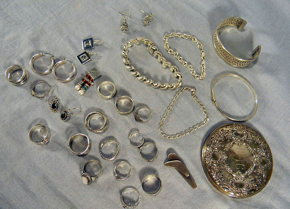 Lot of sterling silver jewelry including bracelets, ear