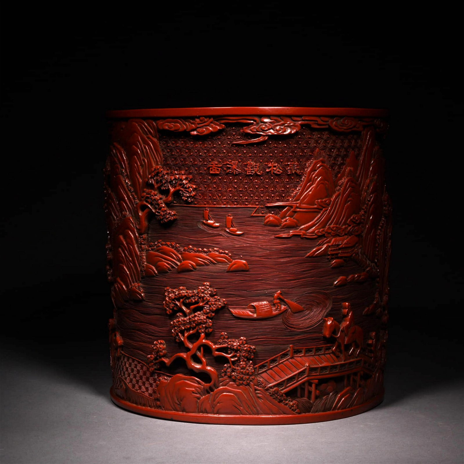 A CHINESE CARVED WOOD LAQUERED BRUSH POT
