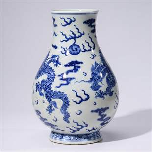 A CHINESE BLUE & WHITE PORCELAIN DRAGON VASE MARKED