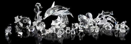27 Swarovski crystal animal figures including dolphins,
