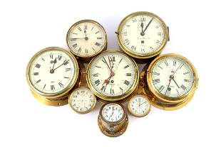 8 ship clocks in brass case