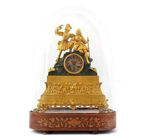 Brass ormolu mantel clock with hunters on top