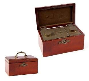Burr walnut veneer tea box with copper fittings and tea