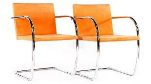 2 chromed tubular frame cantilever chairs