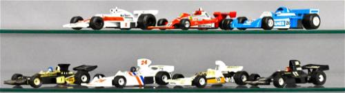Group of seven Positil and Corgi 1/32 and 1/36 Indy