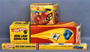 Group of three Mattel Hot Wheels Track sets and Drivin'