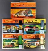 Group of five Mattel Hot Wheels Popup cases