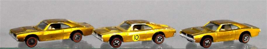 Group of three Gold Mattel Hot Wheels Redline Dodge