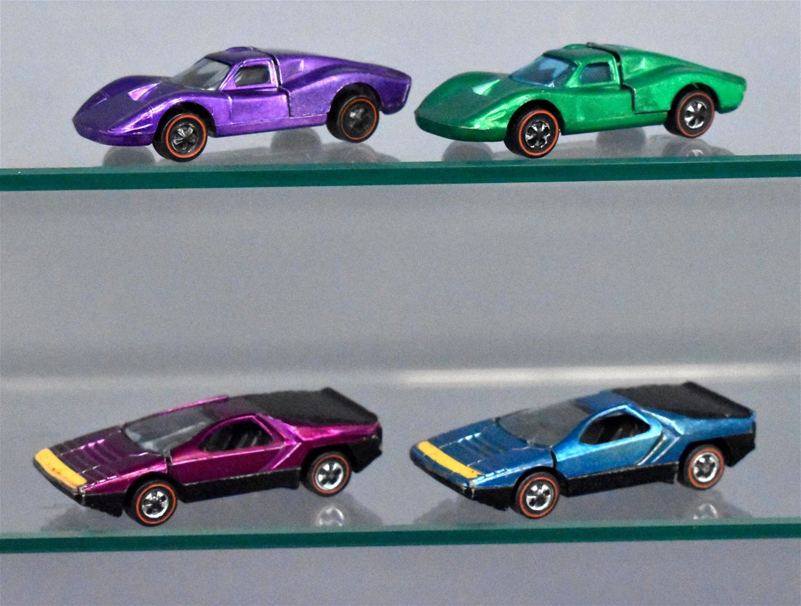 Group of four Mattel Redline Hot Wheels Carabos and
