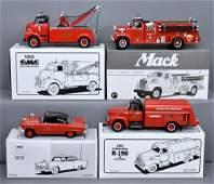 Four First Gear 1/34 die cast trucks in original boxes