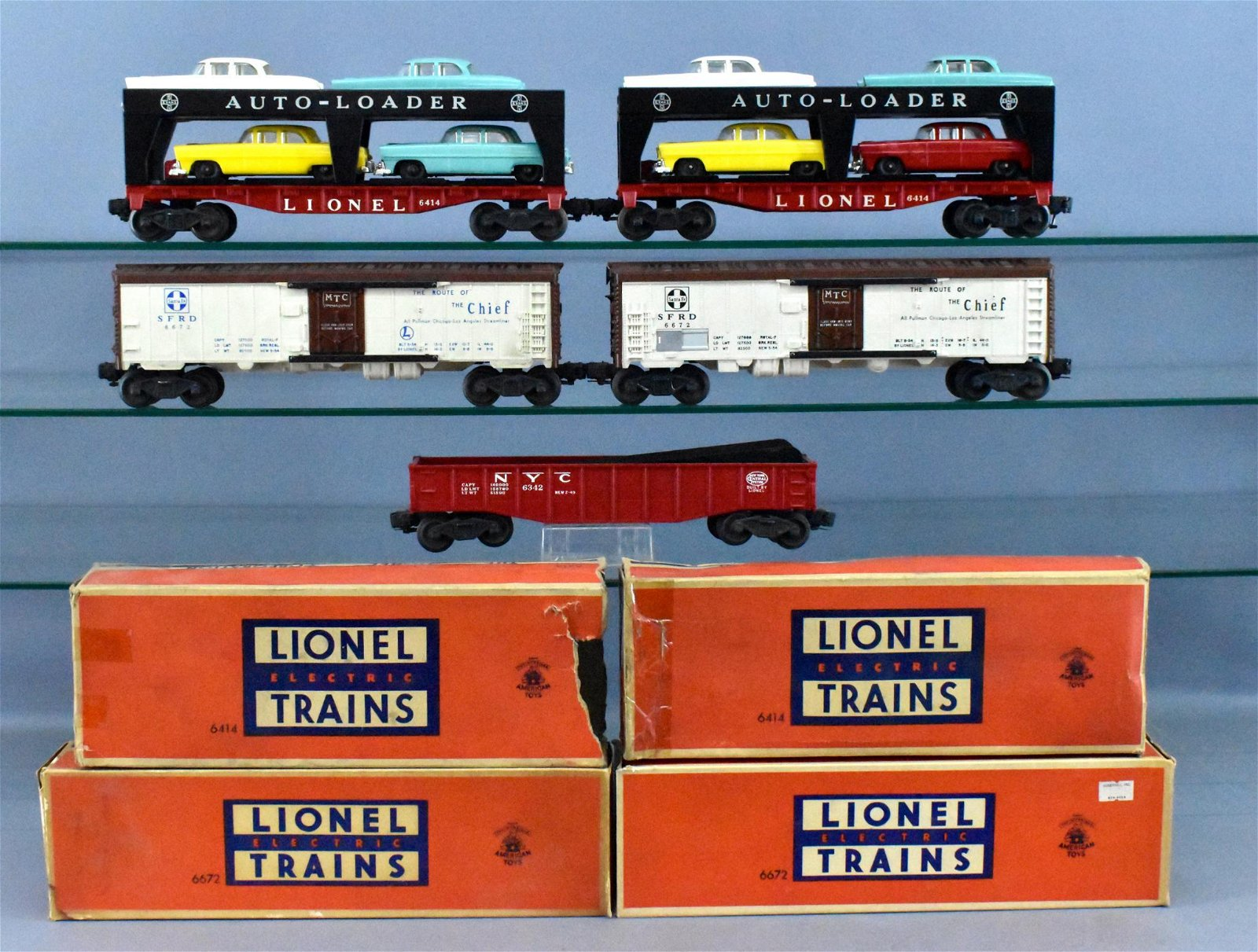 Group of Lionel postwar O freight cars w/ four OBs 6414