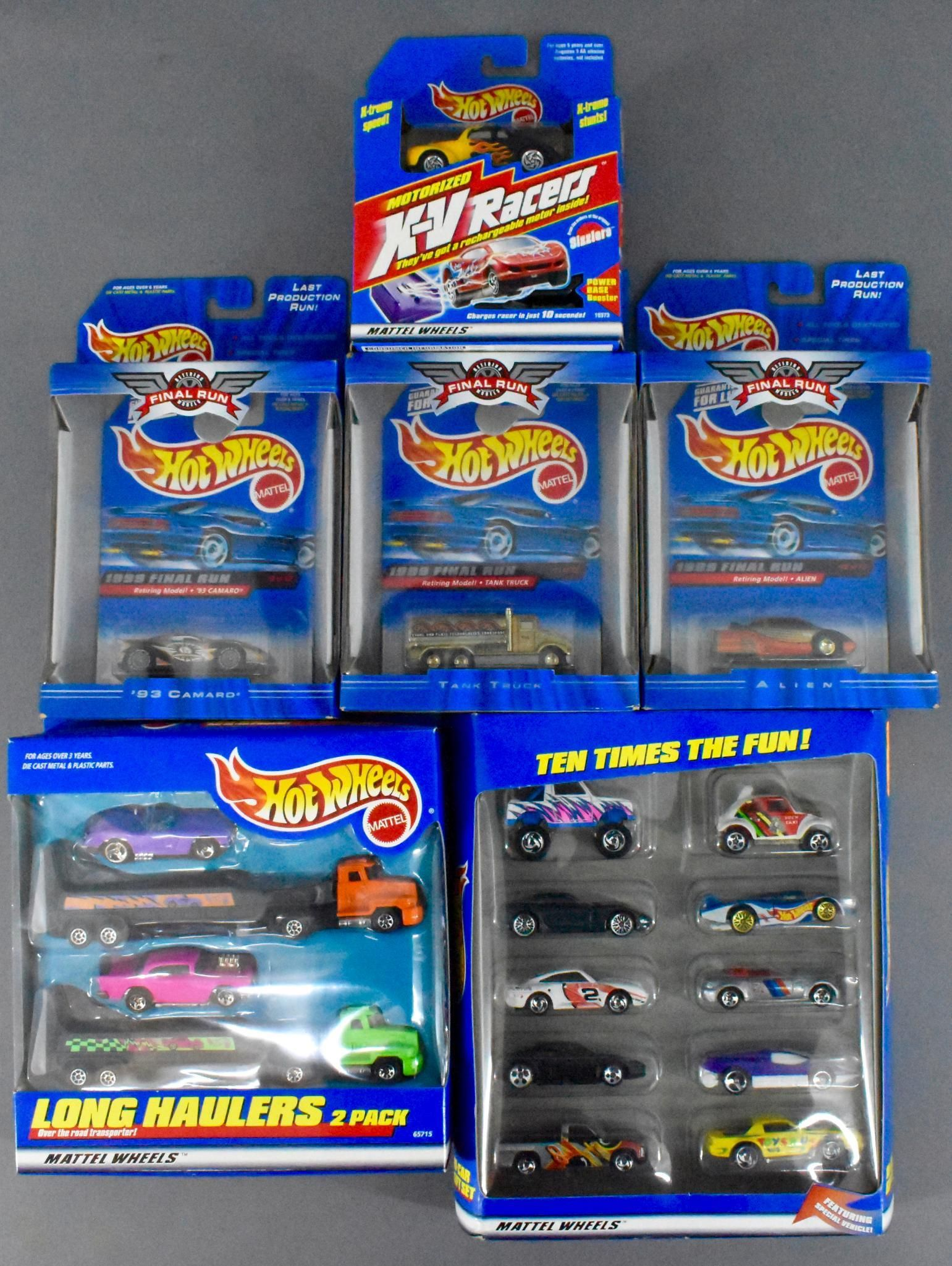 Group of Hot Wheels cars and sets in original boxes