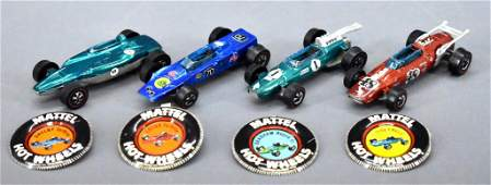 Four Redline Hot Wheels race cars with original buttons