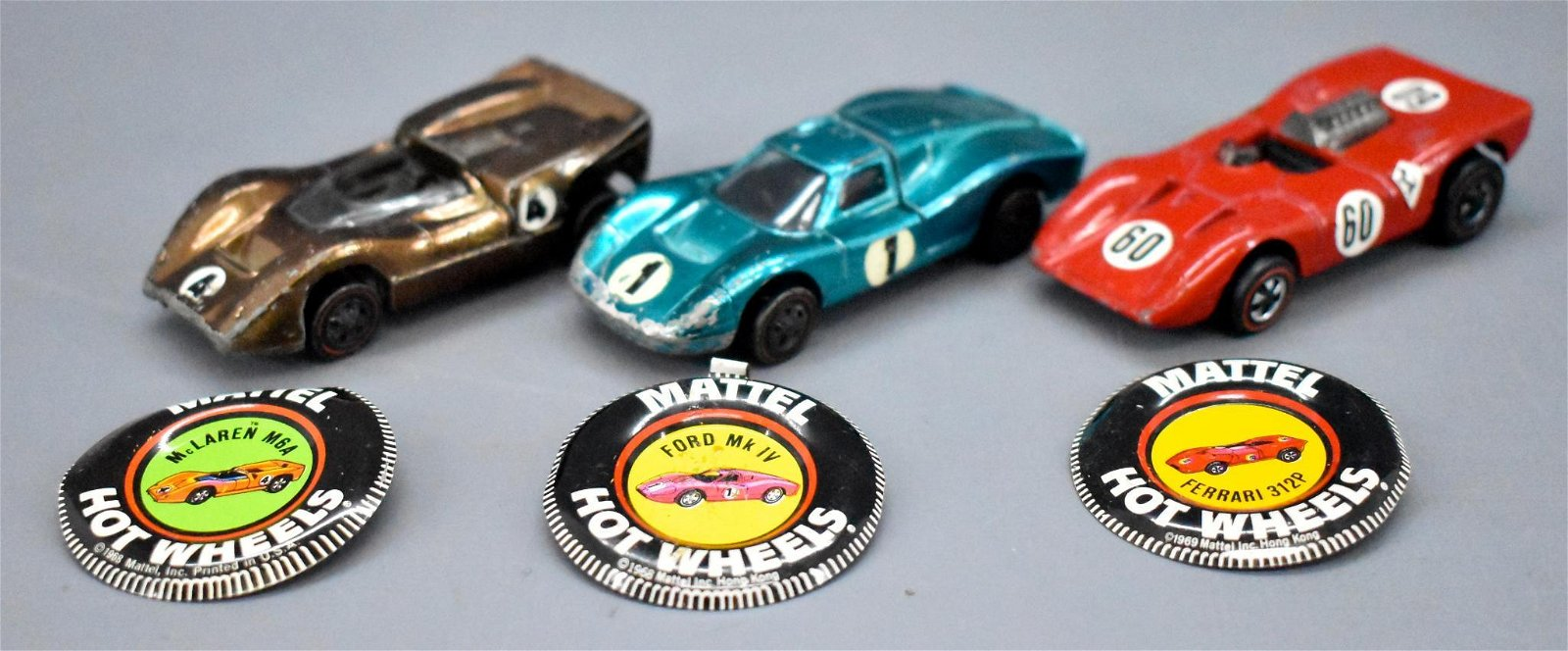 Three Redline Hot Wheels European race cars with