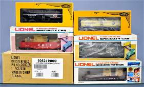 Six Lionel modern era O freight cars in original boxes
