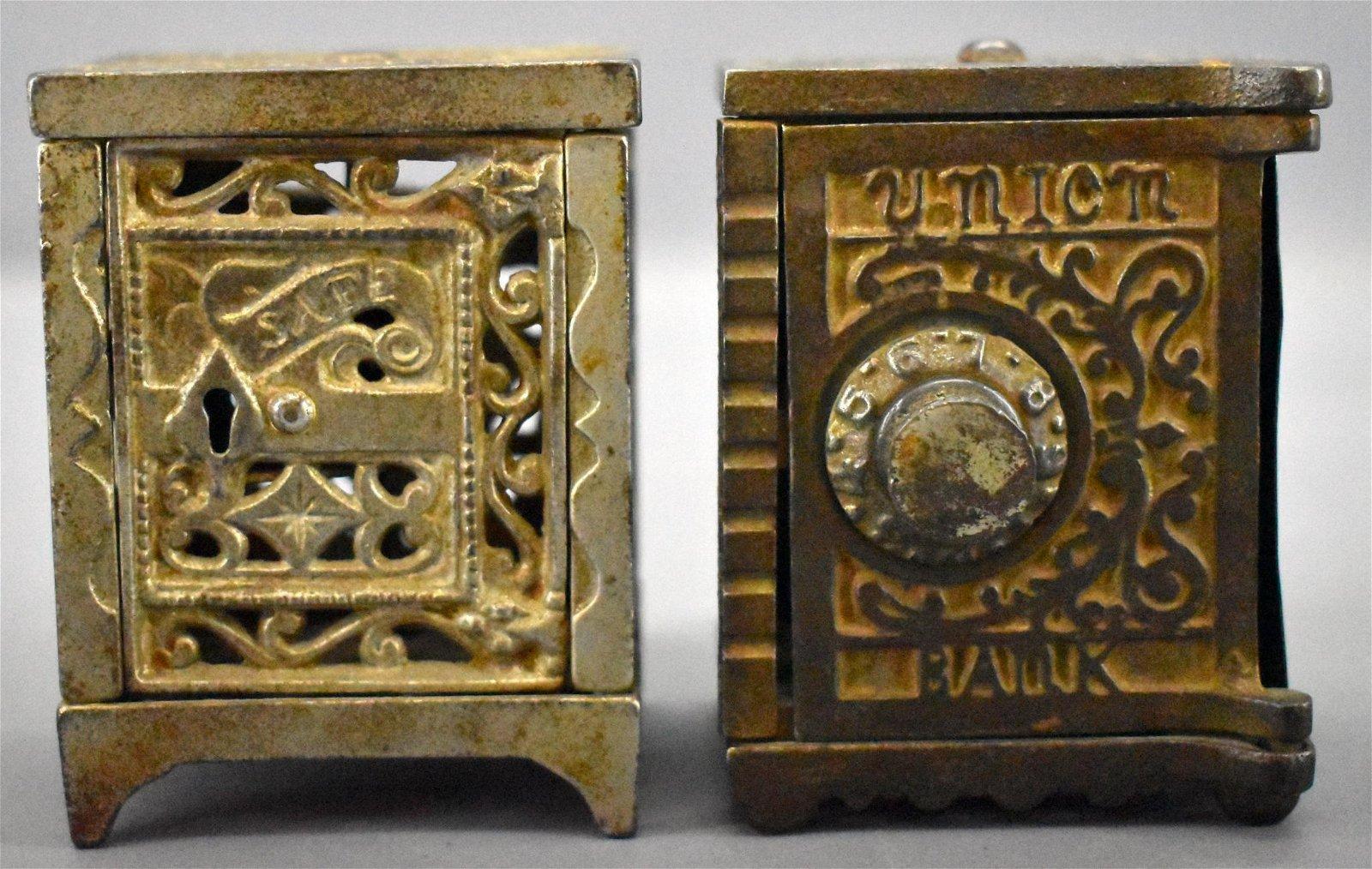 Two antique cast iron still banks J and E Stevens /