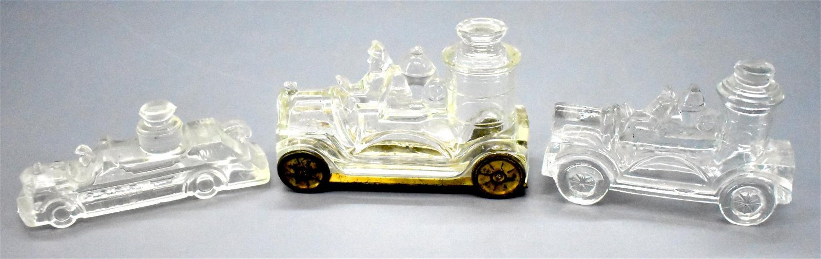 Three vintage glass candy container fire trucks