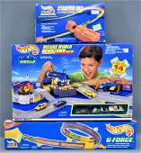 Three Hot Wheels boxed track sets MIB