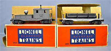 Lionel postwar O 2411 flat car and 2420 caboose in