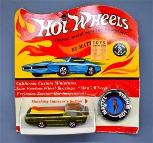 Redline Hot Wheels gold US Deora on a sealed Cheetah