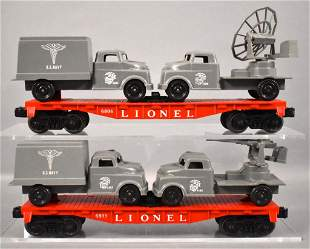 Two Lionel postwar O flat car with Pyro military loads