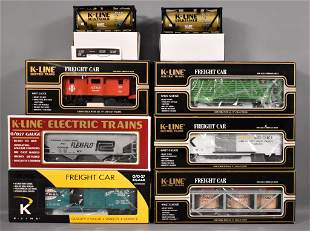 Six K-Line O gauge freight cars in original boxes plus