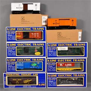 Nine K-Line O gauge freight cars in original boxes