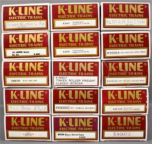 Fifteen K-Line O gauge box cars and other freight in