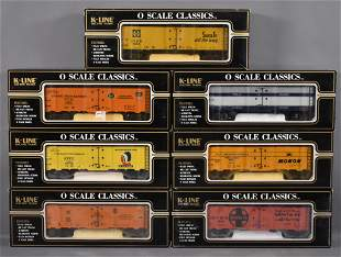 Seven K-Line O gauge classic box cars and reefers in