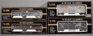 Four K-Line O gauge die cast freight cars in original