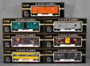 Seven K-Line O gauge freight cars in original boxes