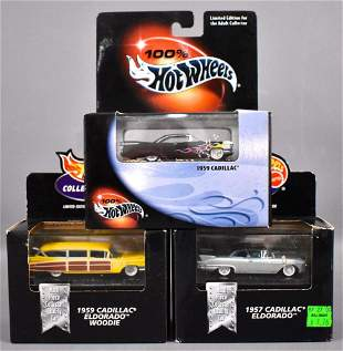 Three 100% Hot Wheels Cadillac die cast cars in