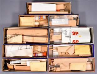 Nine vintage unbuilt Ambroid HO scale craftsman rolling