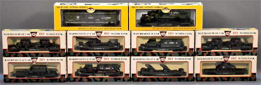 Ten Model Power HO scale US Army train cars with loads